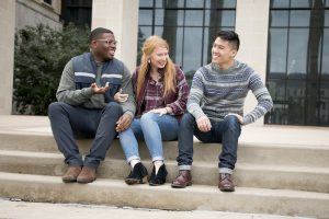 3 students on steps